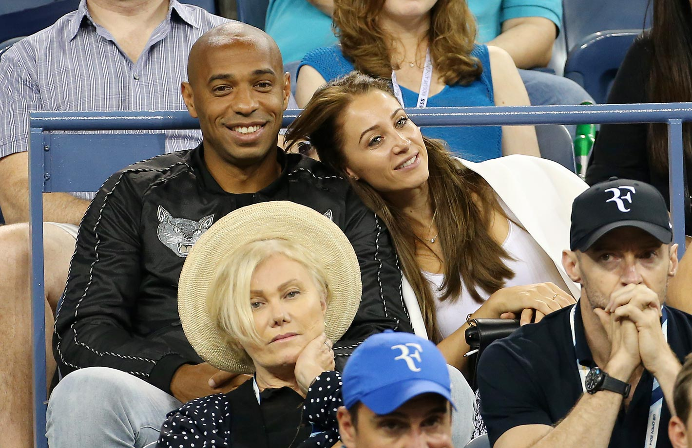 NEW YORK, NY - SEPTEMBER 4: Thierry Henry and his girlfriend Andrea Rajacic attend the match between Roger Federer of Switzerland and Gael Monfils of France during Day 11 of the 2014 US Open at USTA Billie Jean King National Tennis Center on September 4, 2014 in the Flushing neighborhood of the Queens borough of New York City. (Photo by Jean Catuffe/GC Images)