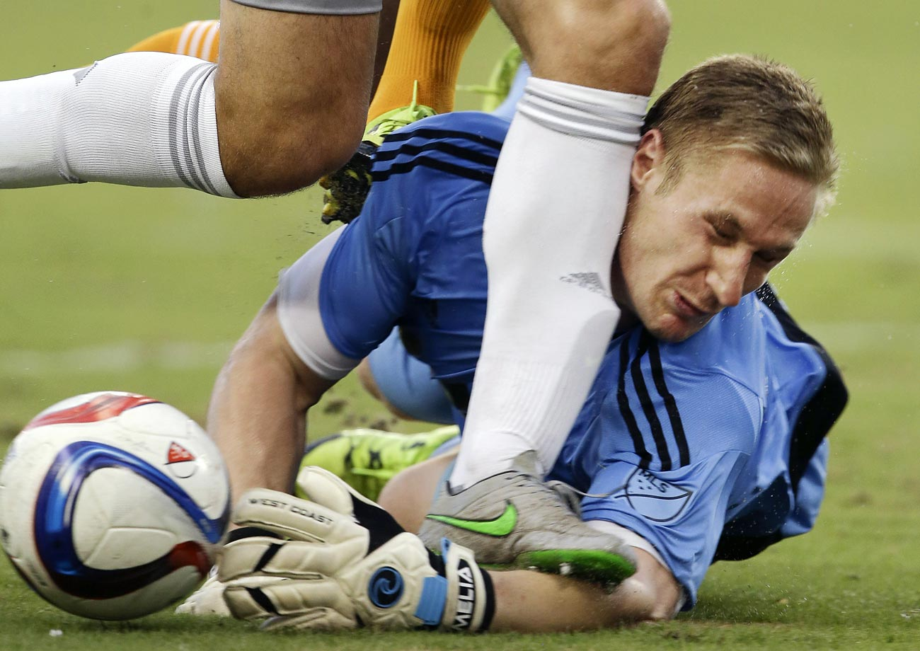 Goalkeeper Tim Melia makes a save during a MLS soccer match between the Houston Dynamo and Sporting Kansas City.