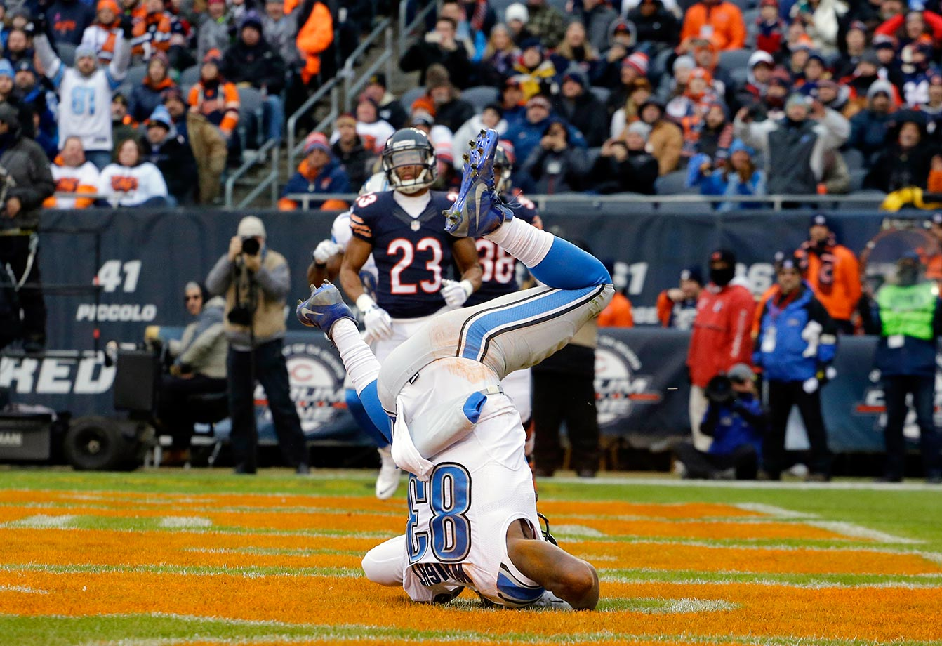 Timothy Wright of the Detroit Lions falls as he makes a touchdown catch against the Chicago Bears.