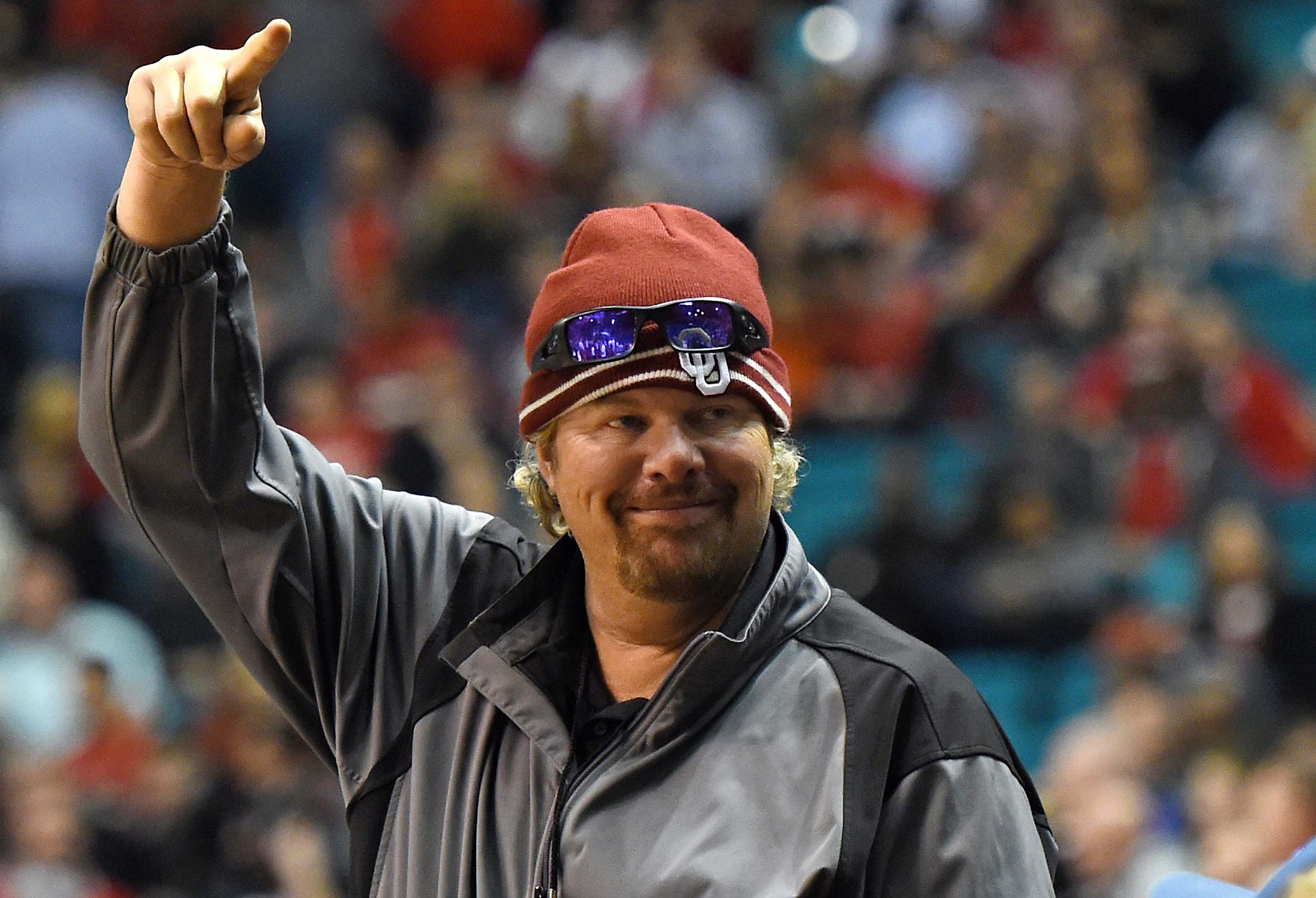 Recording artist Toby Keith acknowledges fans as he attends the 2014 game between the Oklahoma Sooners and the Washington Huskies at the MGM Grand Garden Arena in Las Vegas.