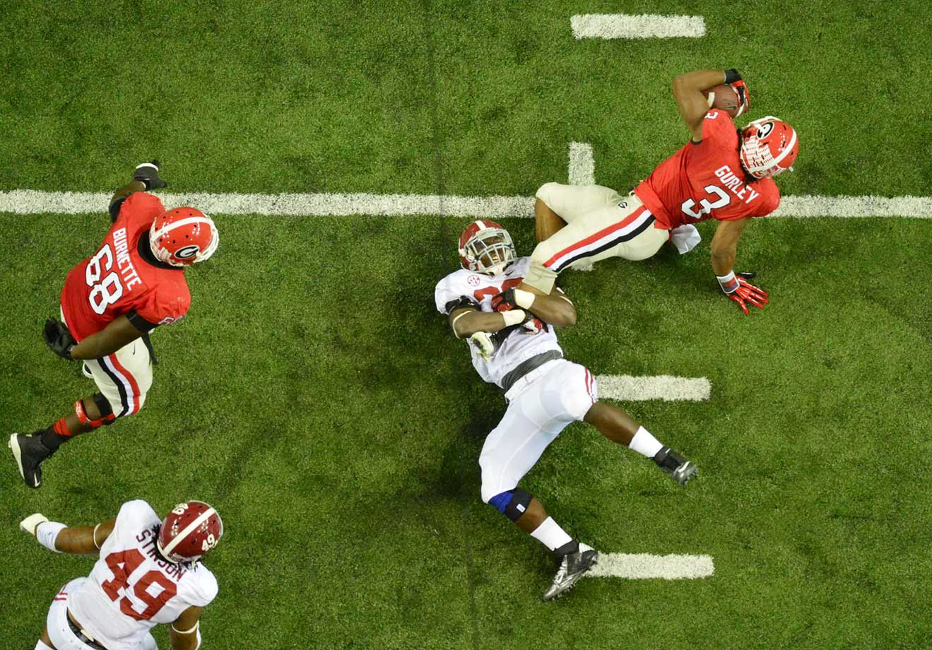 Georgia running back Todd Gurley being tackled by an Alabama defender in the 2012 SEC Championship game.