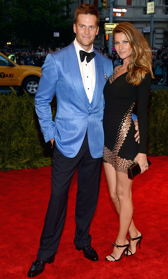 You know that a man is well dressed when the woman on his arm is Giselle and you're still looking at his incredible blue blazer.