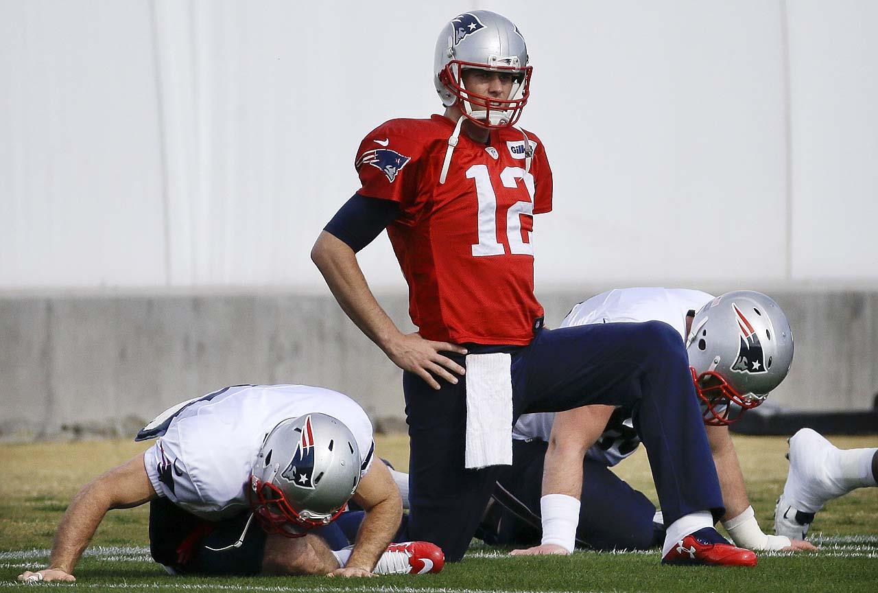 Patriots quarterback Tom Brady stretches during practice Wednesday.