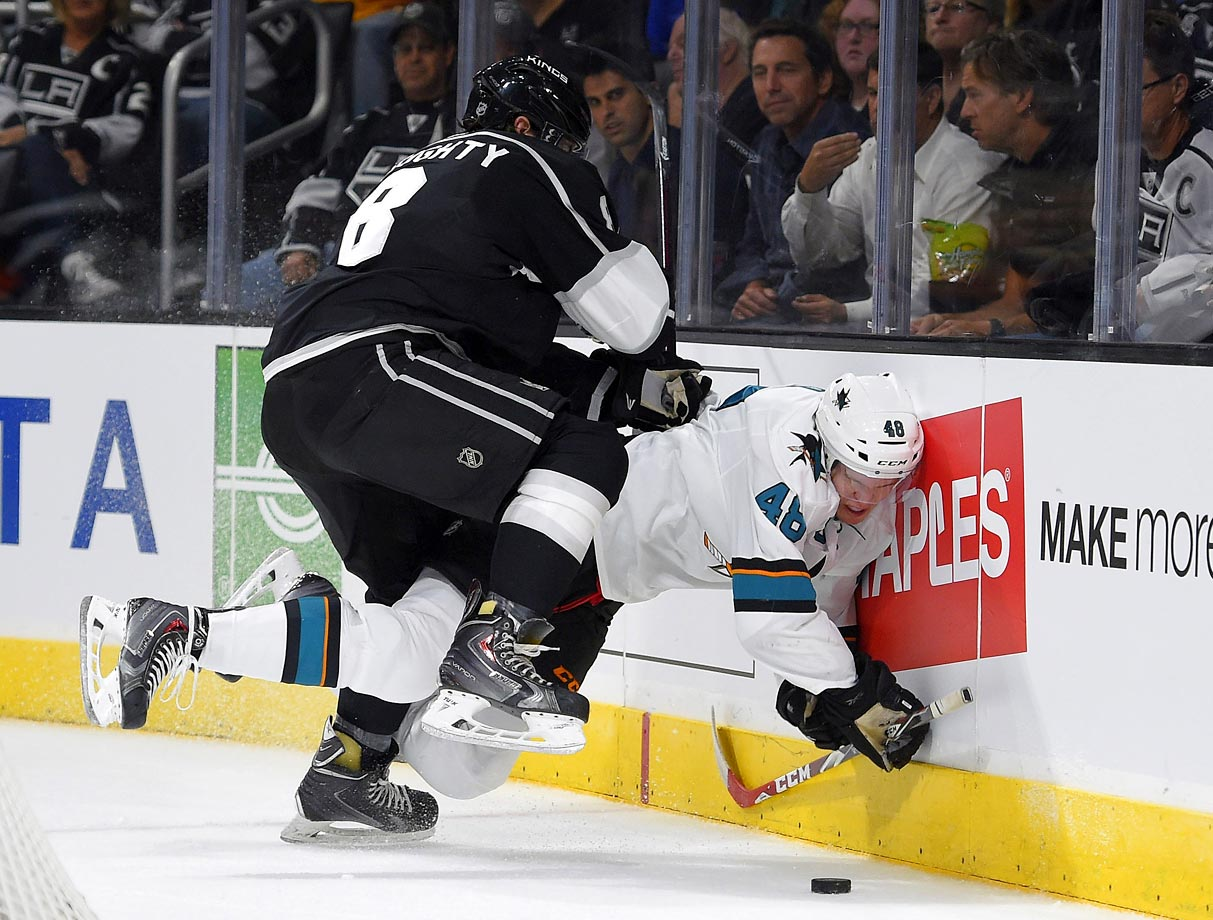 Hertl is pushed into the boards by Doughty during the Sharks-Kings game on Oct. 8 in Los Angeles. Doughty received a penalty for boarding on the play.