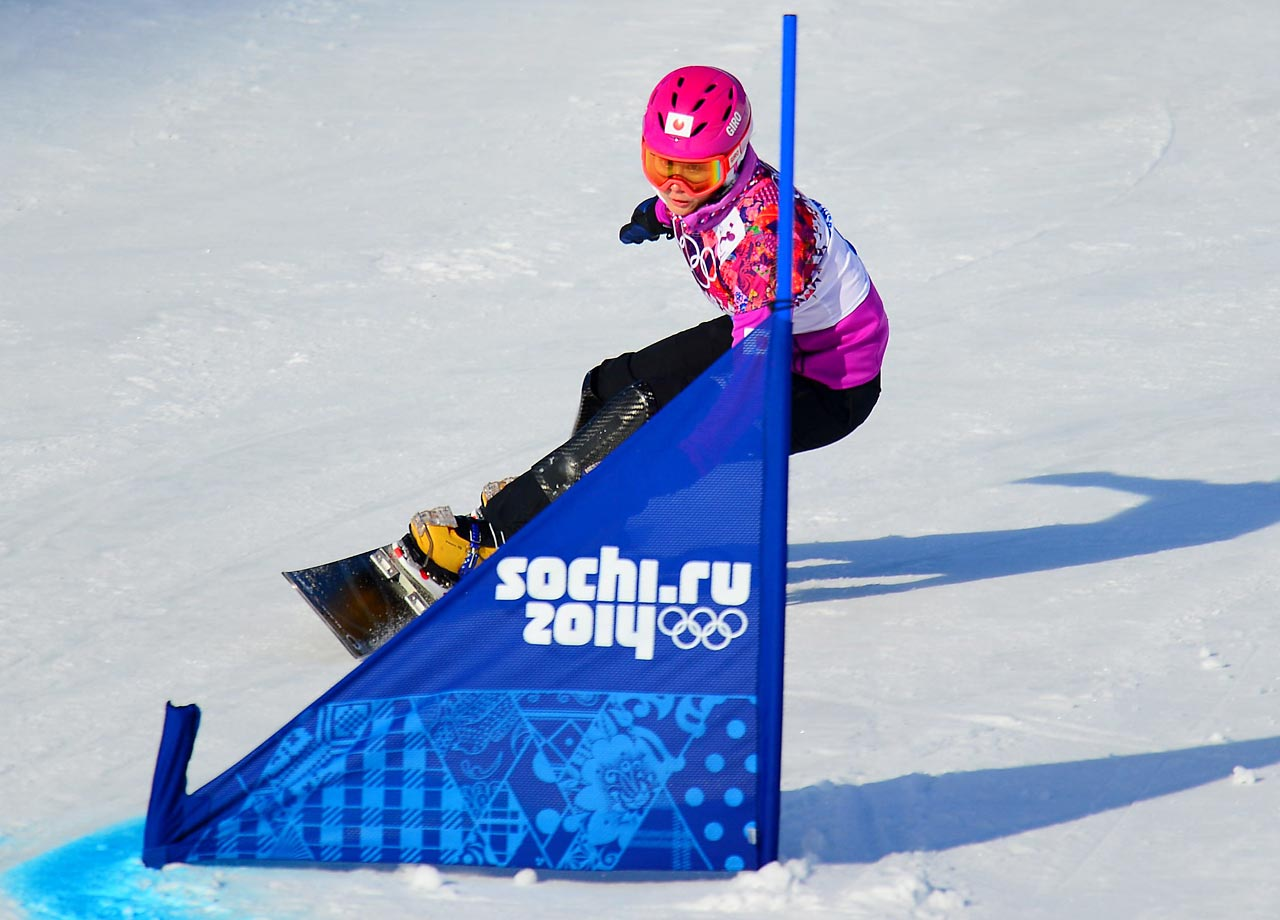 Japanese snowboarder Tomoka Takeuchi glides through the snow during qualification for the ladies' parallel giant slalom.
