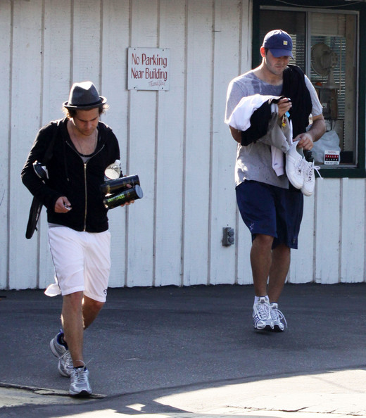 Ryan Cabrera and Romo leave the tennis courts after playing against each other in California.