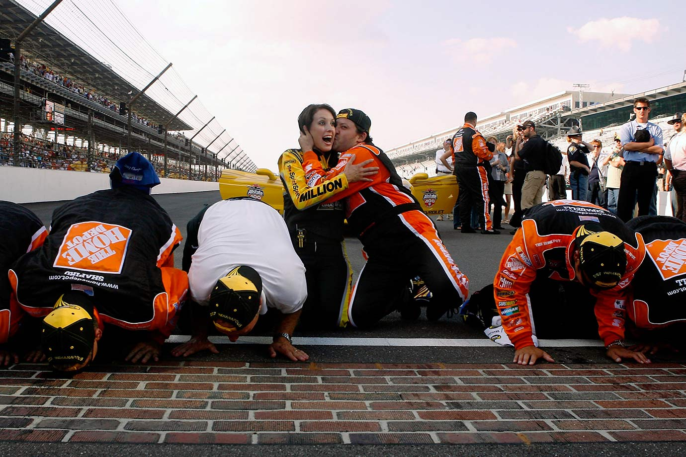 Tony Stewart, who this week announced plans to retire after the 2016 season, is pictured kissing Miss Sprint Cup after his second race win at Indianapolis Motor Speedway. The Columbus, Ind., native also kissed the bricks in 2005.