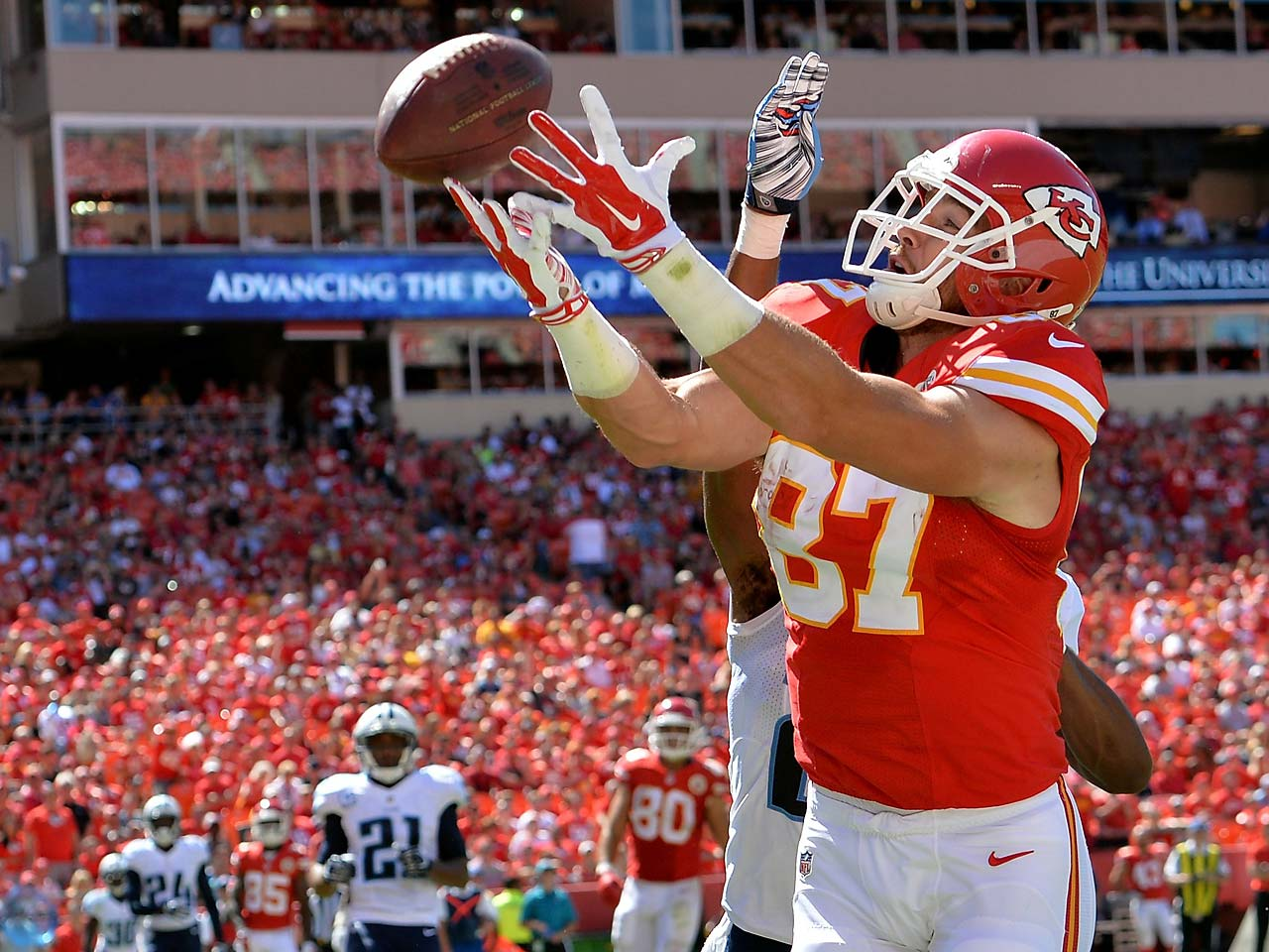 Travis Kelce of the Kansas City Chiefs reaches out for the ball in the endzone as Blidi Wreh-Wilson of the Tennessee Titans defends during the second half.