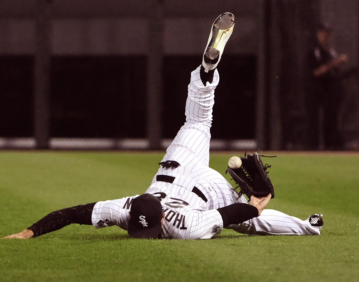 Trayce Thompson of the Chicago White Sox can't catch this hit by Brett Lawrie of the Oakland A's.
