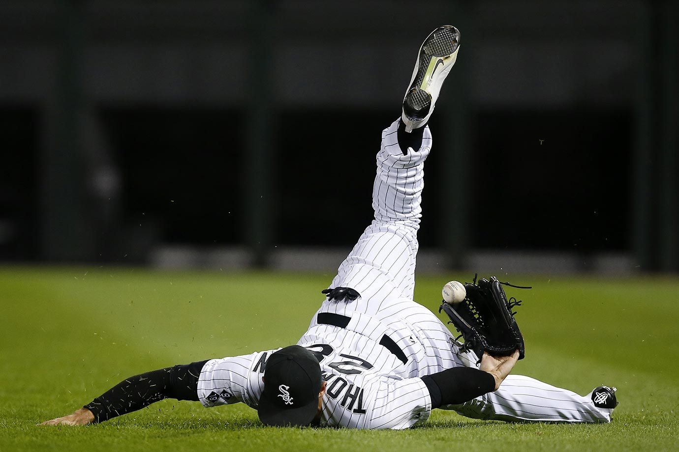 Charles McQuillan of the Chicago White Sox loses the ball on a double hit by Brett Lawrie of the A's.