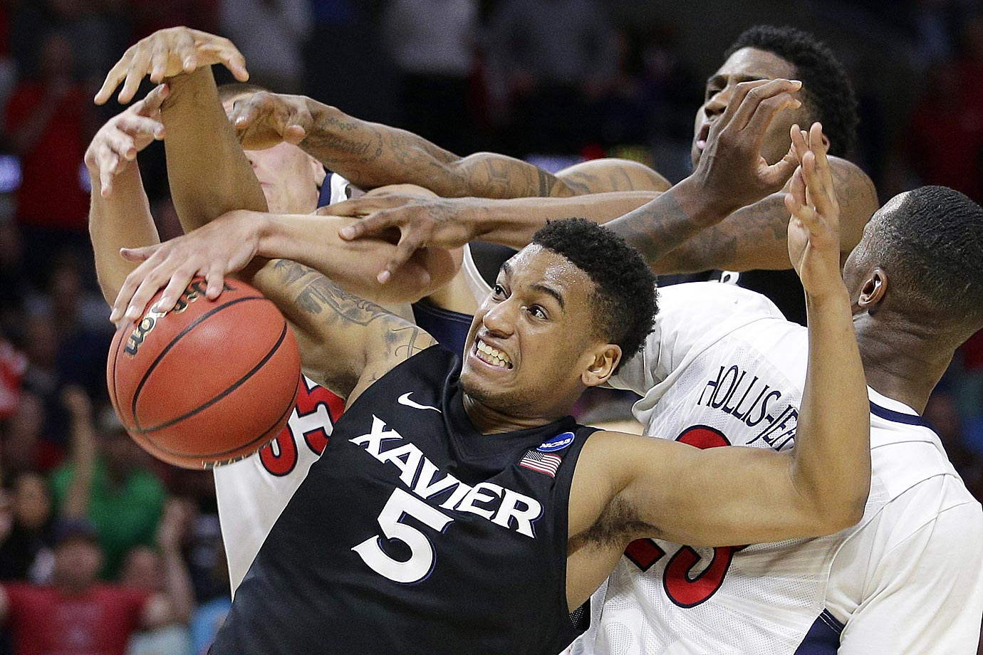 Trevon Bluiett of Xavier gets tangled against Arizona during the regional semifinal.