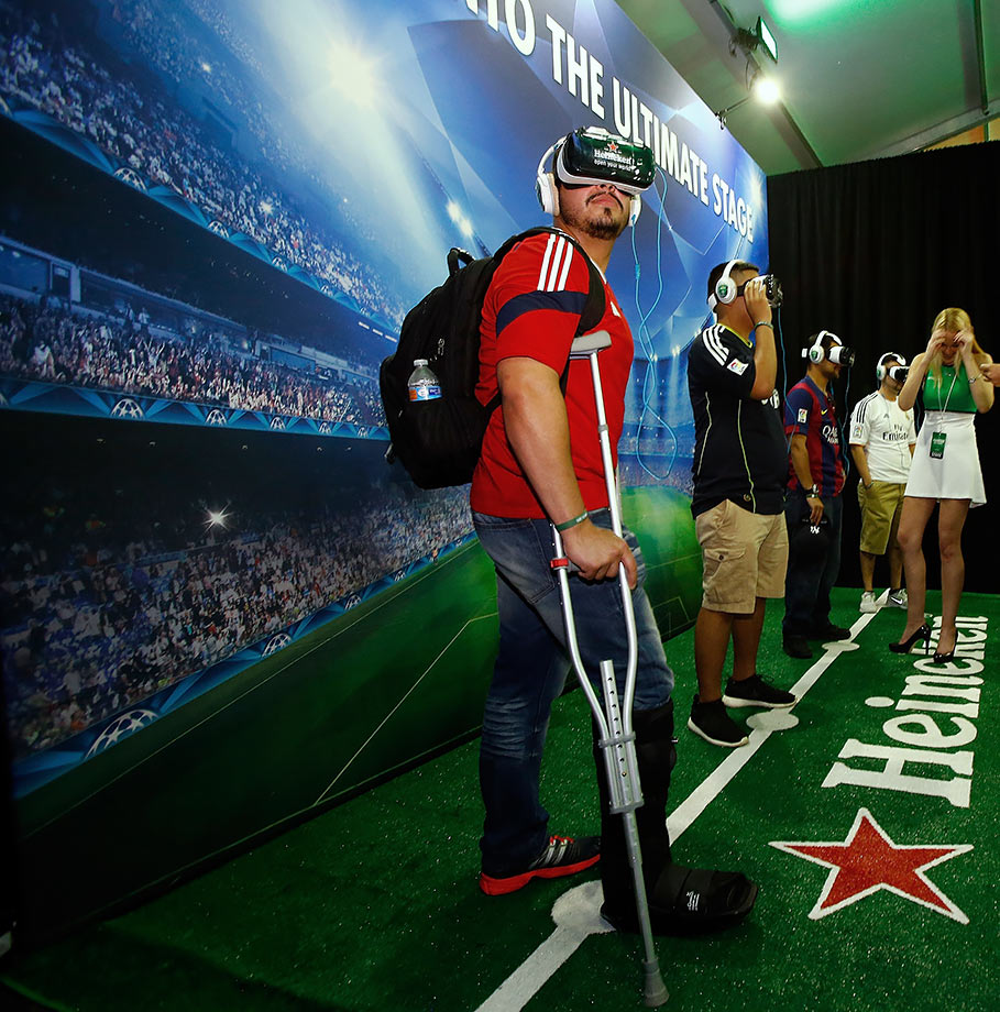 Fans participate in a virtual reality exhibit at the 2015 UEFA Champions League Trophy Tour on April 18, 2015 in Dallas.