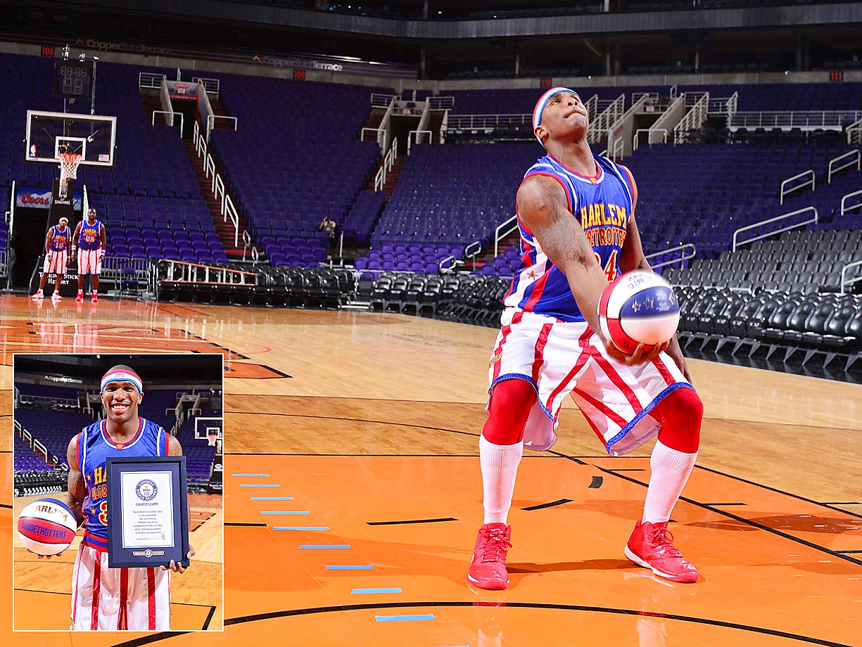 The farthest basketball shot made backwards was 25 m (82 ft 2 in) by Thunder Law of the Harlem Globetrotters in honor of Guinness World Records Day 2014.