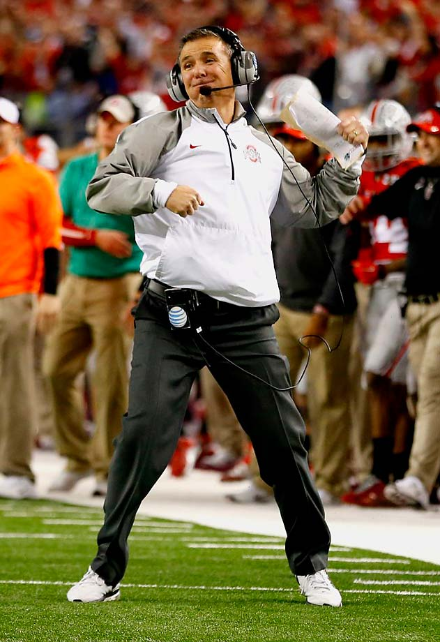 Ohio State Buckeyes coach Urban Meyer fist pumps during his team's 42-20 win over the Oregon Ducks.