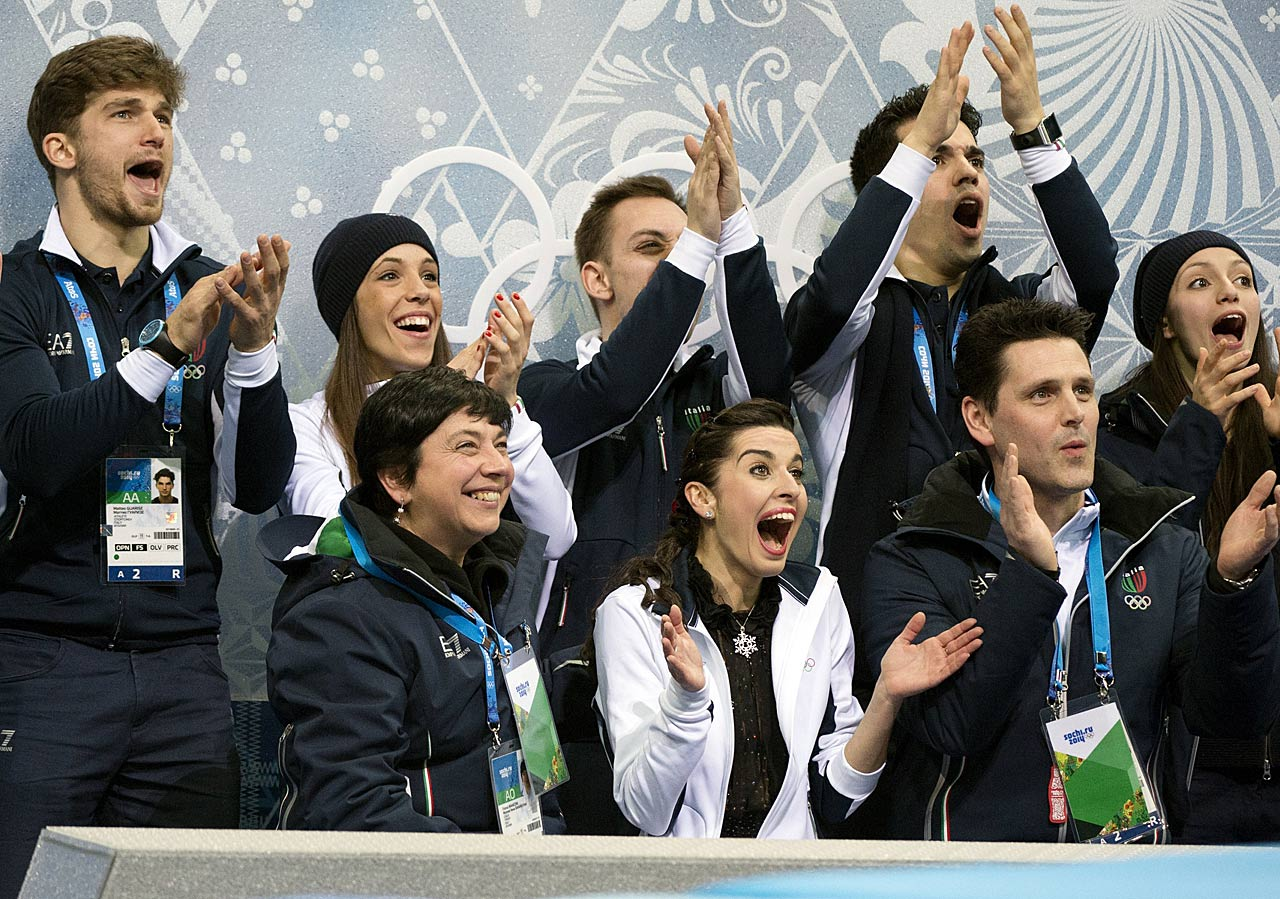 Valentina Marchei and the Italian contingent react to a score in the team skating competition.