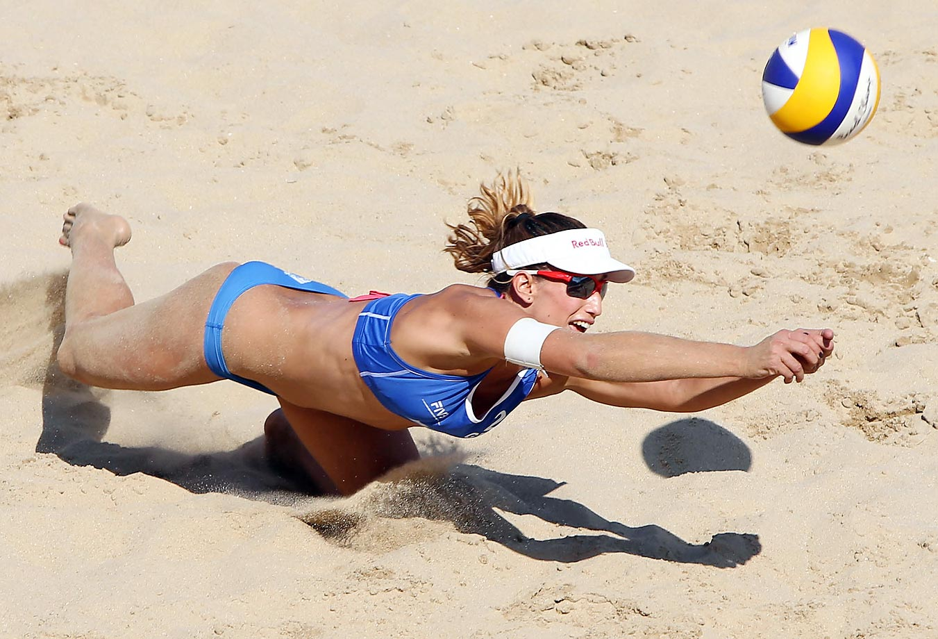 Vasiliki Arvaniti of Greece dives for the ball at the 2014 FIVB Beach Volleyball World Tour Xiamen Open.