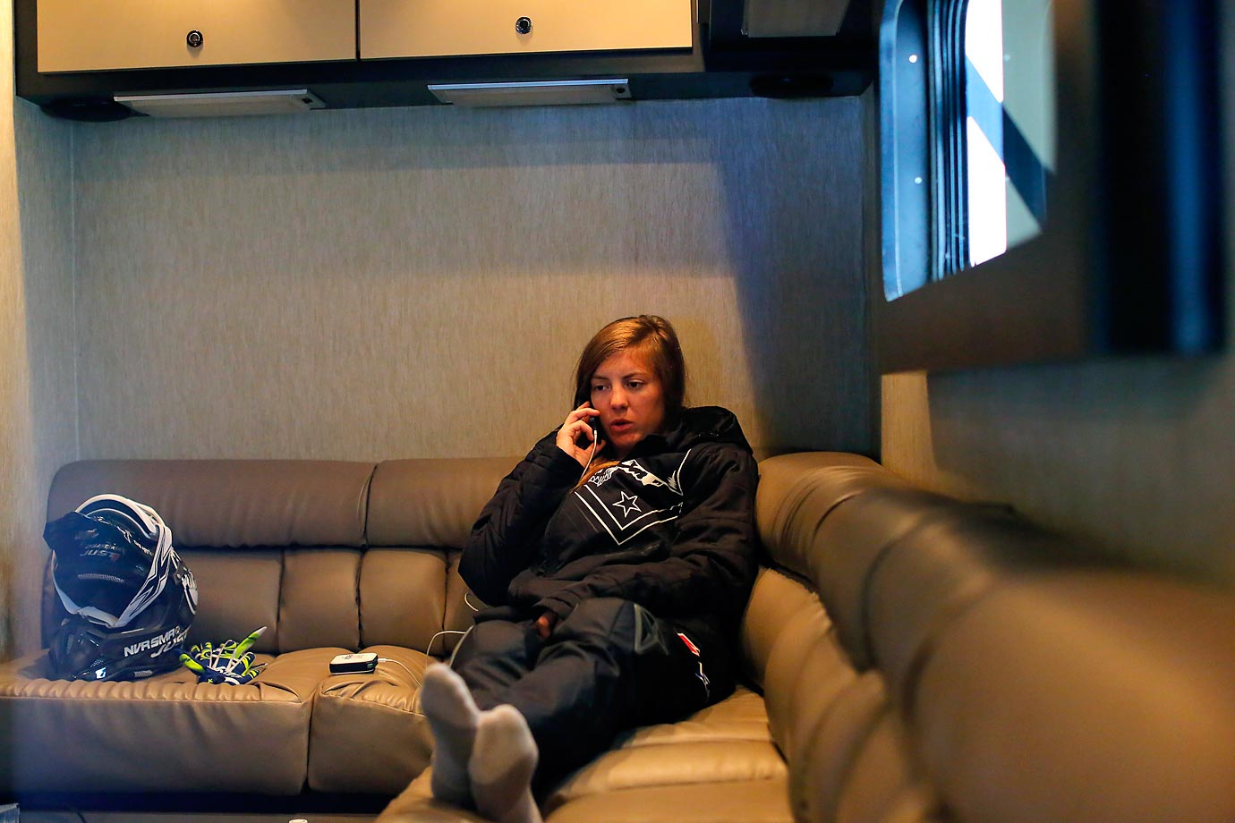 Vicki relaxes in her racing team's ( Hansen Racing ) trailer and talks on her cell prior to race day in Arlington, TX.