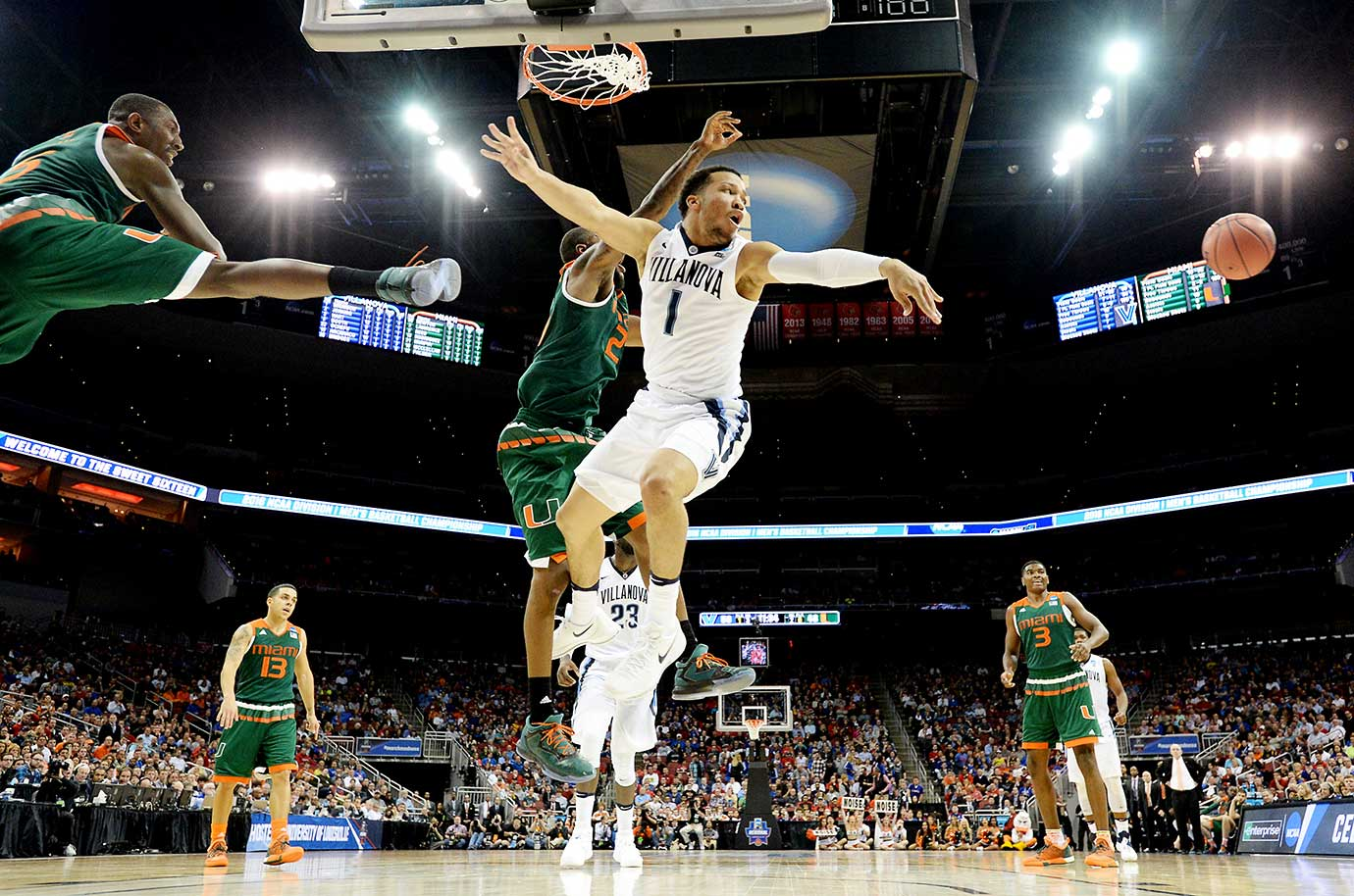 Jalen Brunson of Villanova finds himself surrounded by Miami defenders.