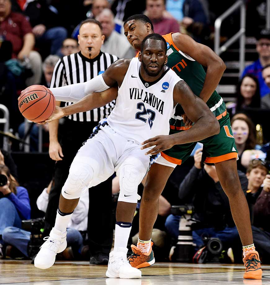 Daniel Ochefu of Villanova has the ball knocked away by a Miami defender.