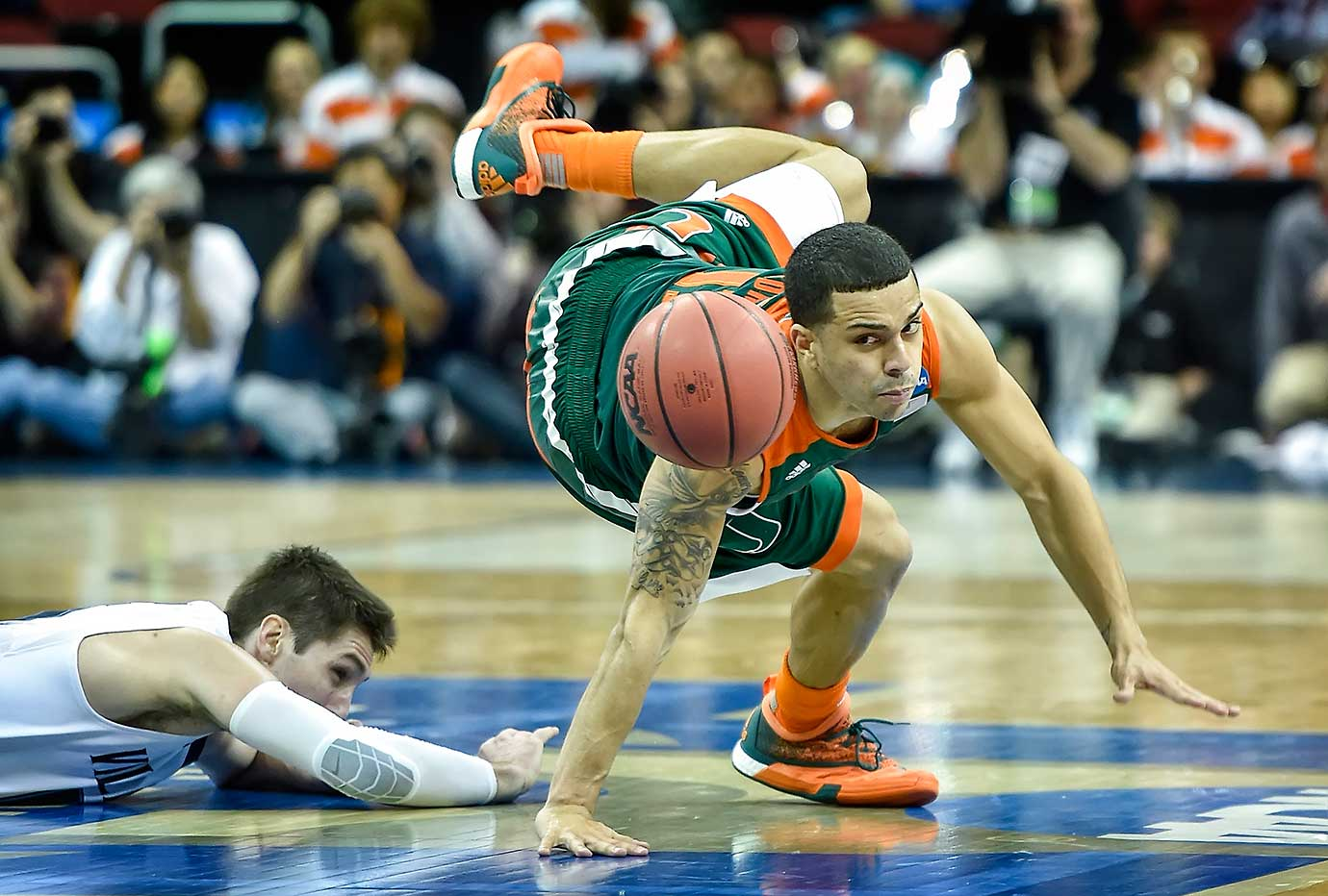 Miami's Angel Rodriguez loses control of the ball with Villanova's Ryan Arcidiacono defending.