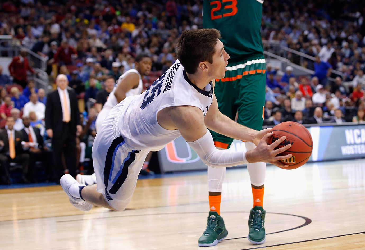 Ryan Arcidiacono of Villanova attempts to prevent the ball from going out of bounds against Miami.