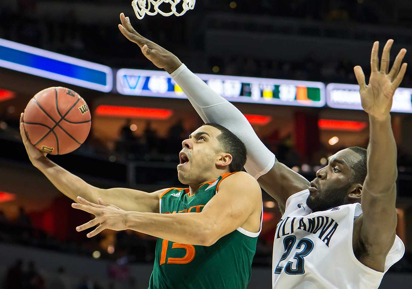 Miami's Angel Rodriguez drives to the basket past Villanova's Daniel Ochefu.