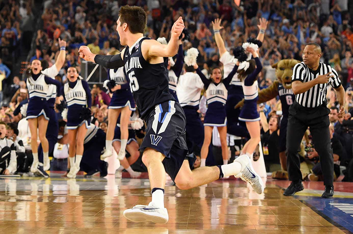 Ryan Arcidiacono runs around in joy after his assist to Kris Jenkins earned Villanova the national basketball title.
