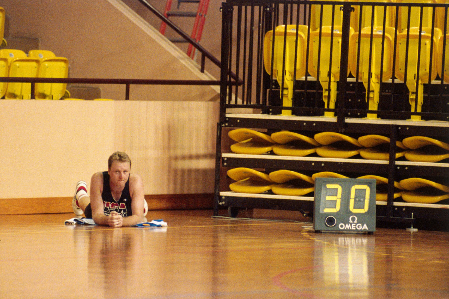 NBA Dream Teamer Larry Bird lies on the court resting his back during a practice in June 1992 in Monte Carlo.