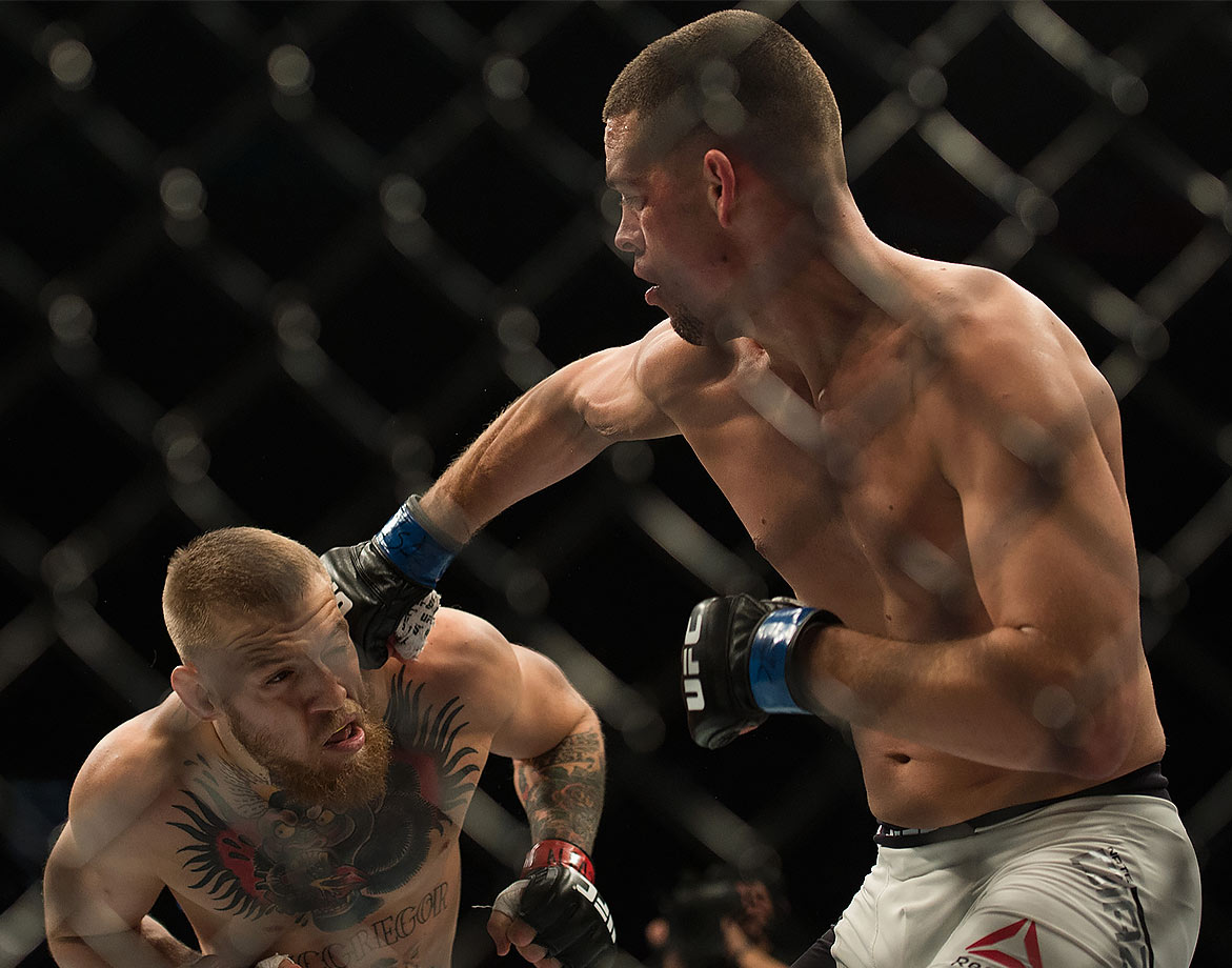 Nate Diaz punches Conor McGregor in their welterweight bout during the UFC 196 in the MGM Grand Garden Arena on March 5, 2016 in Las Vegas, Nevada.