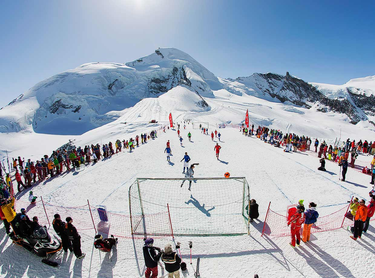 Footballers from Italy's FC Piedimulera and Switzerland's FC Gspon play on a snow field in Saas-Fee, Switzerland.