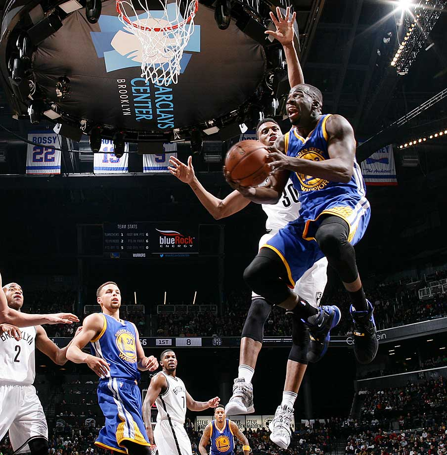 Draymond Green goes underneath for a shot against the Brooklyn Nets.