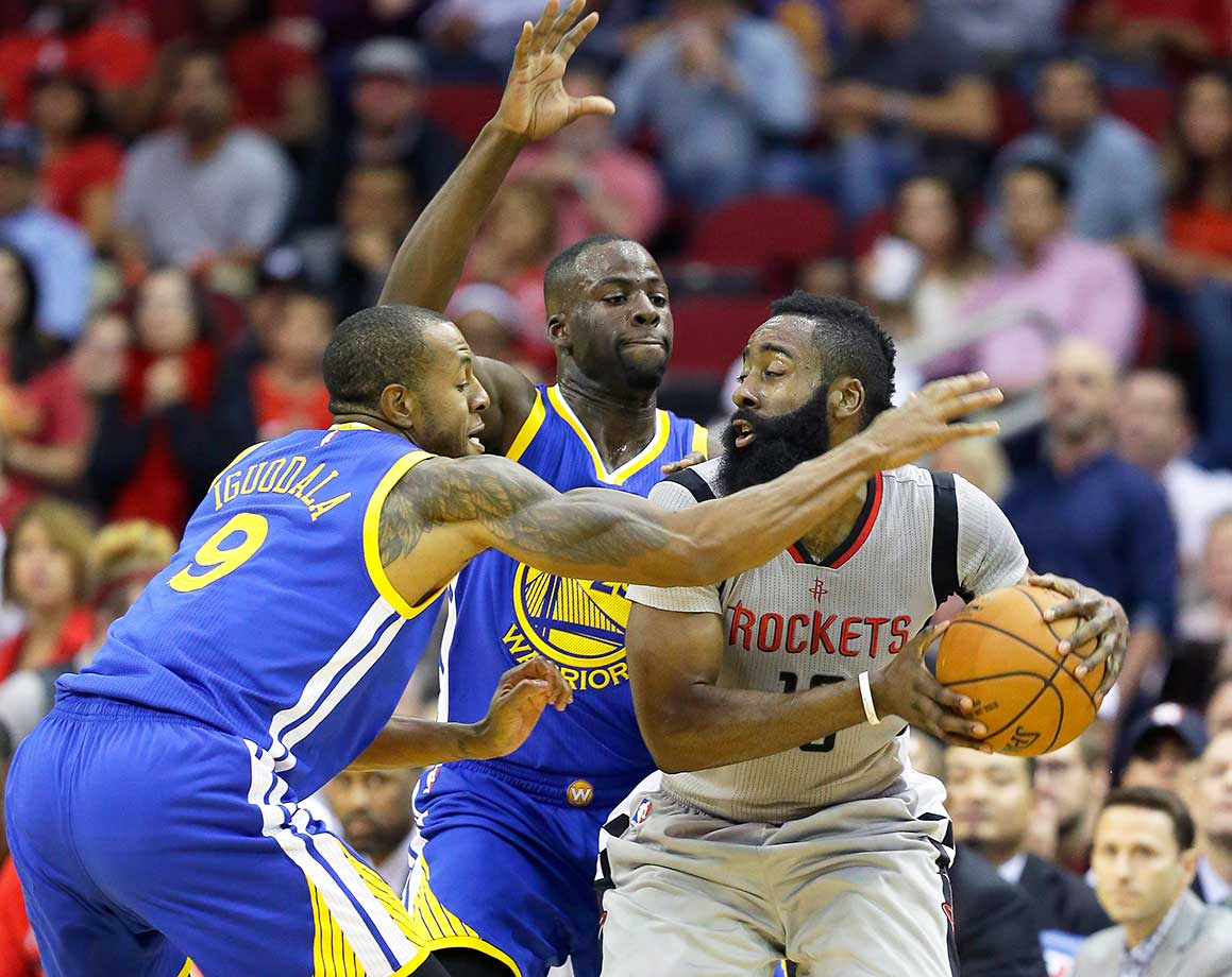 Andre Iguodala, left, and Draymond Green double-team James Harden in a rematch of the previous season's Western Conference finals.