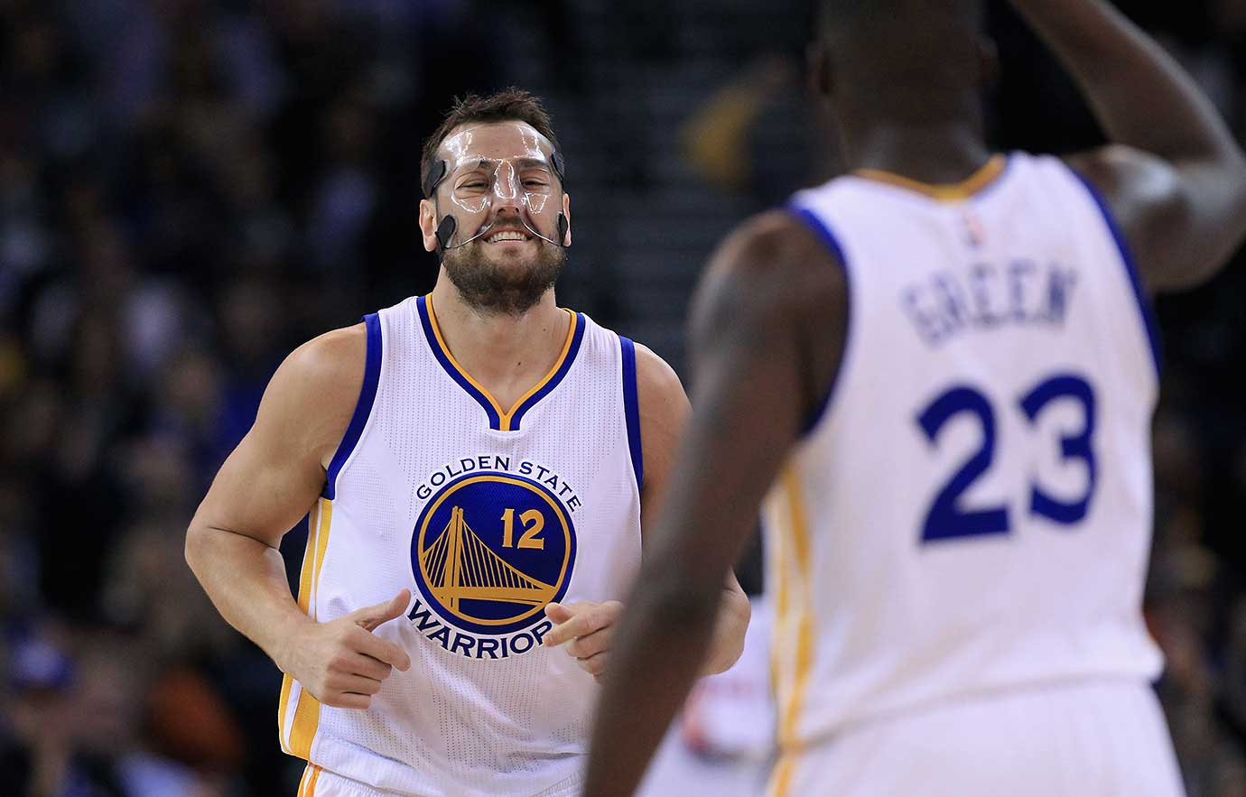 Wearing a protective mask and playing in his first game since suffering a concussion in the season opener, Andrew Bogut put in 20 minutes and had eight points and nine rebounds against Detroit.