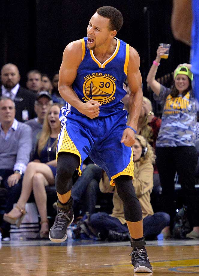 Steph Curry reacts on a night in which Golden State matched the record 9-0 start of the 1960-61 Warriors, who played in Philadelphia at the time.