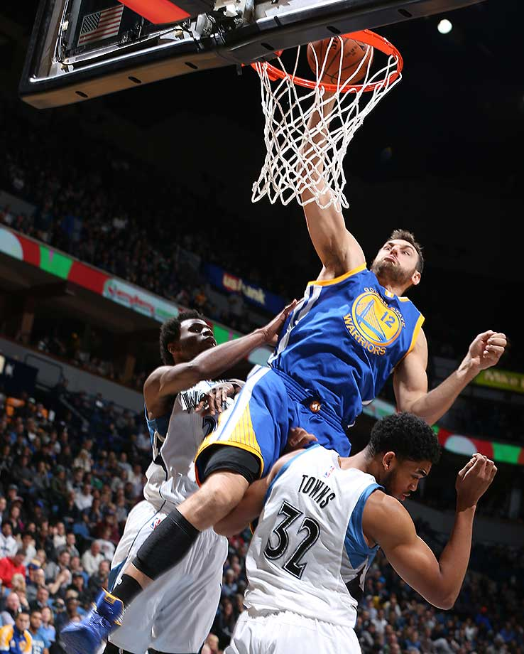Andrew Bogut dunks against the Minnesota Timberwolves as Golden State became the fourth defending champion in league history to start a season 10-0.