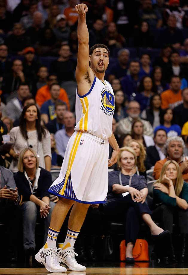 Klay Thompson watches a three-point shot go down—one of the 23 the Warriors hit against Phoenix.