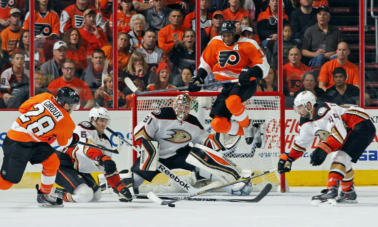 Simmonds jumps as he attempts to set up a screen for Claude Giroux's shot against Ducks goalie Frederik Anderson on Oct. 14 in Philadelphia.