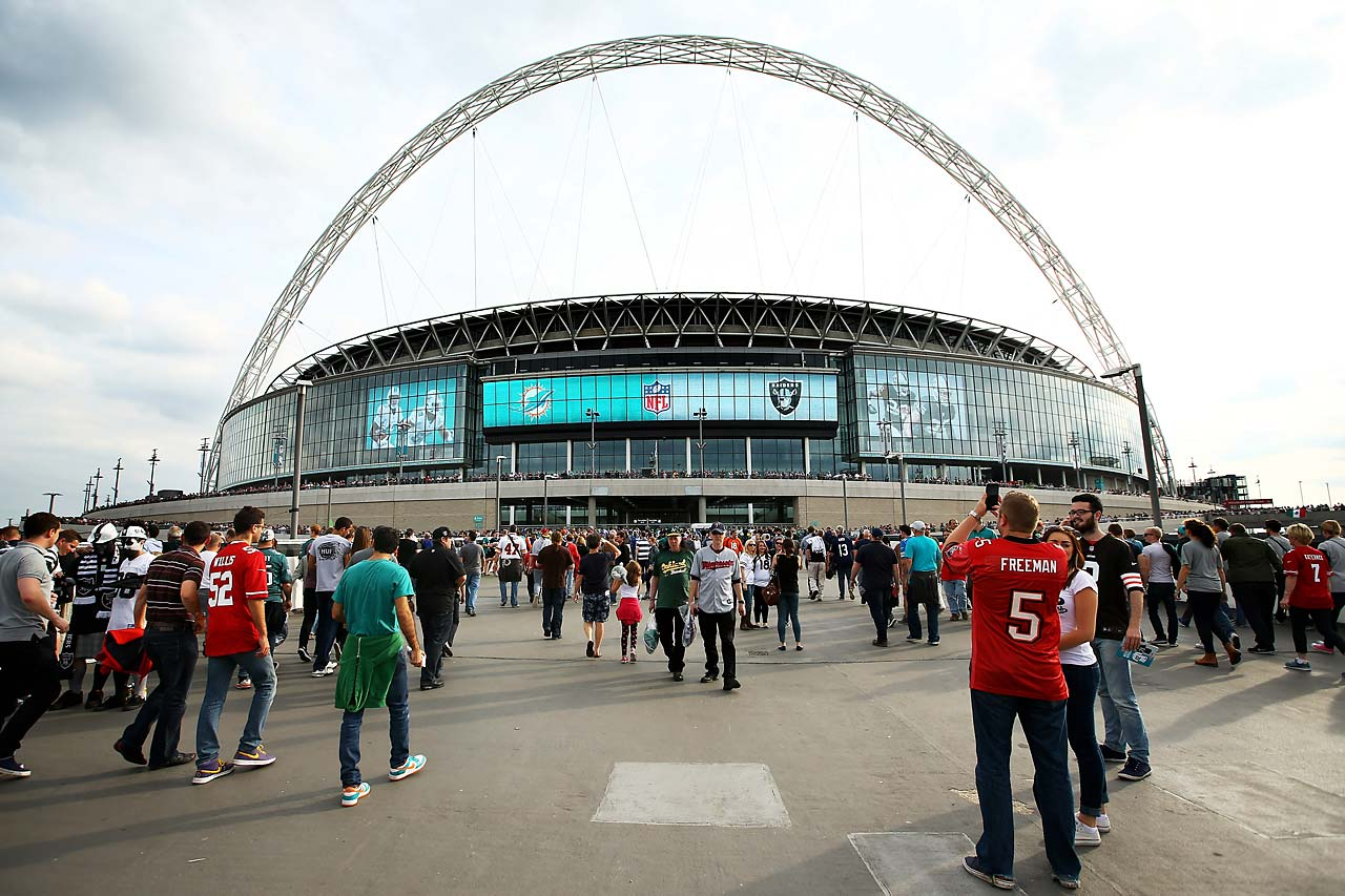 Fans arrive at the stadium prior to kickoff between the Oakland Raiders and the Miami Dolphins at Wembley Stadium.