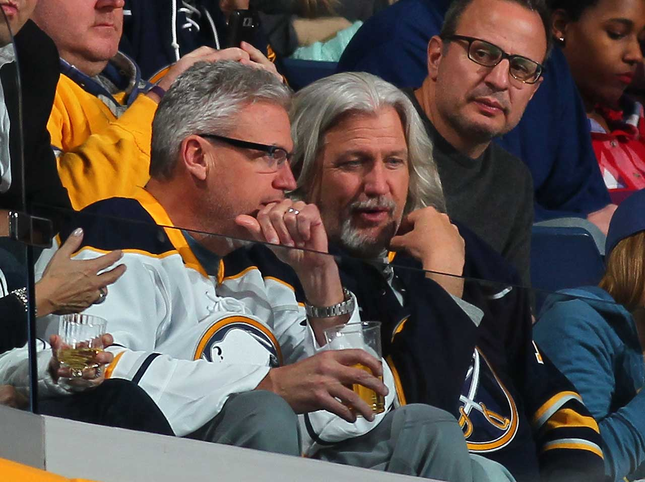 Buffalo Bills head coach Rex Ryan and his brother, Rob, watch the NHL game between the Buffalo Sabres and the Boston Bruins at the First Niagara Center in Buffalo.