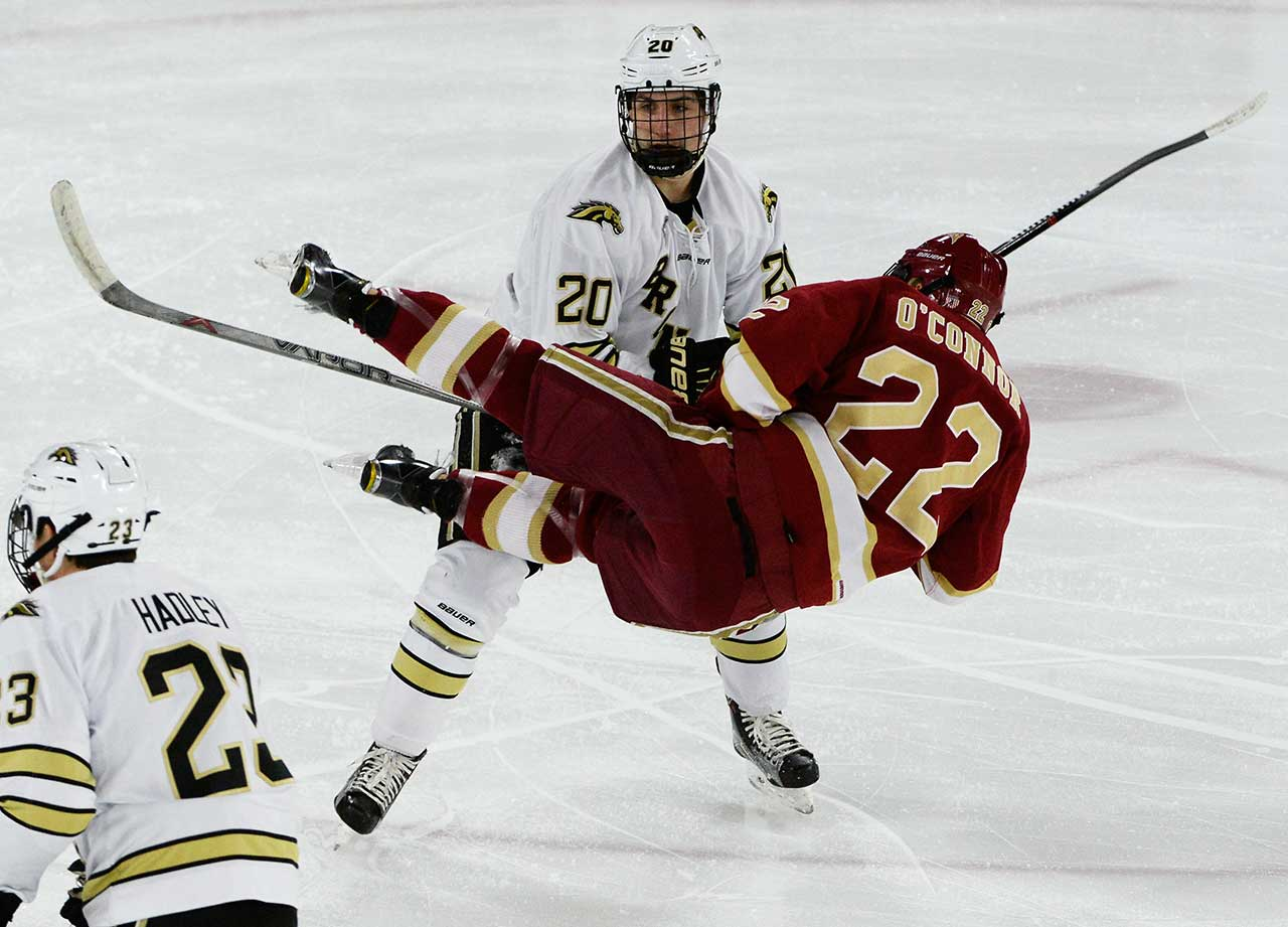 University of Denver Pioneers forward Logan O'Connor gets upended by Western Michigan Broncos defenseman Taylor Fleming  at Magness Arena.