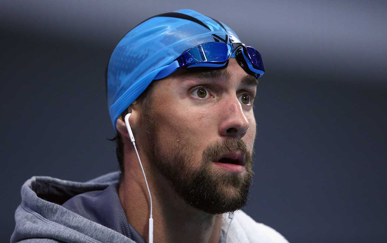 Michael Phelps adjusts his googles before competing in the 100 meter butterfly final during the Arena Pro Swim Series in Austin, Texas, Friday night.