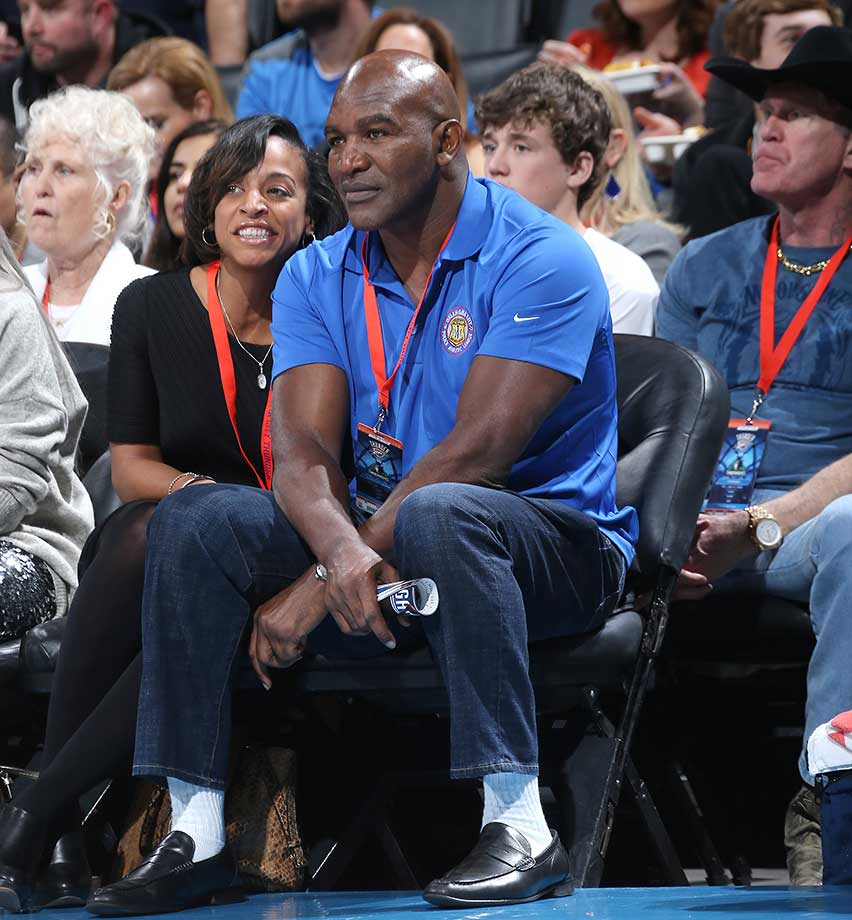Former boxer Evander Holyfield watches the Oklahoma City Thunder game against Minnesota in Oklahoma City.