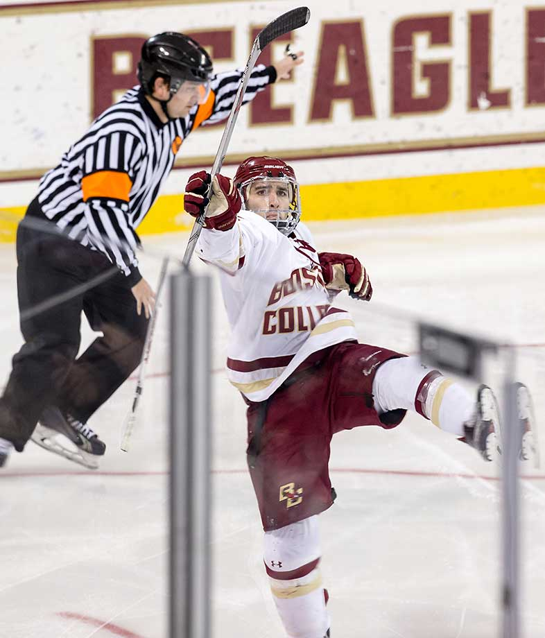 Austin Cangelosi of the Boston College Eagles celebrates his penalty shot goal against Sean Maguire of the Boston University Terriers (not pictured) during a game at Kelley Rink in Chestnut Hill, Mass. The Eagles won 5-3.
