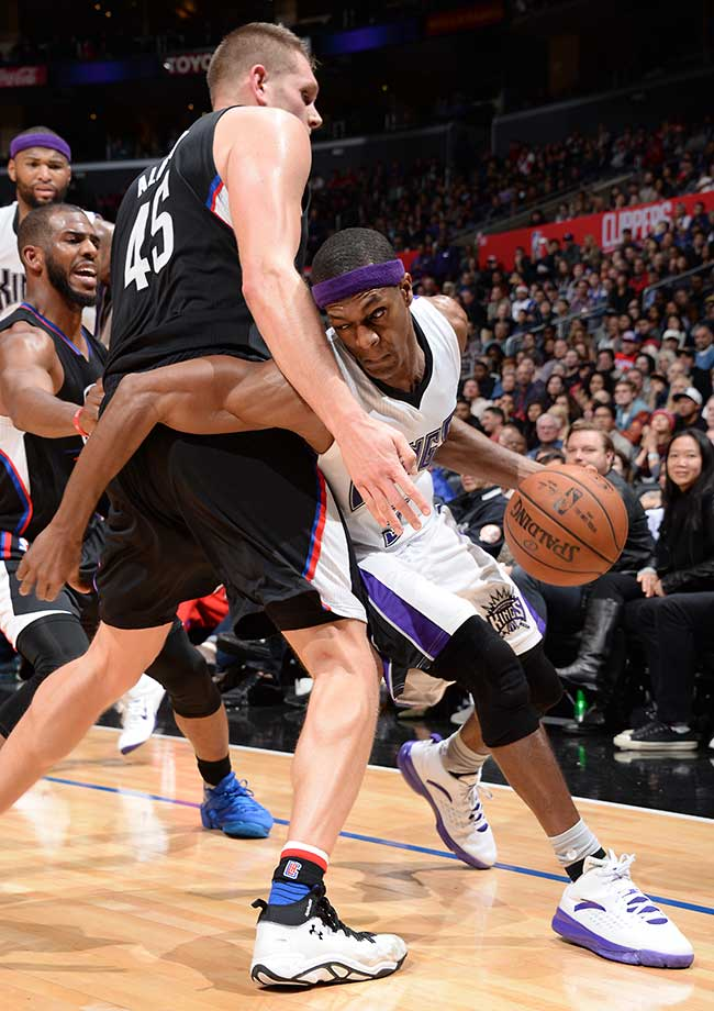 Rajon Rondo of the Sacramento Kings drives to the basket against Cole Aldrich of the Los Angeles Clippers.