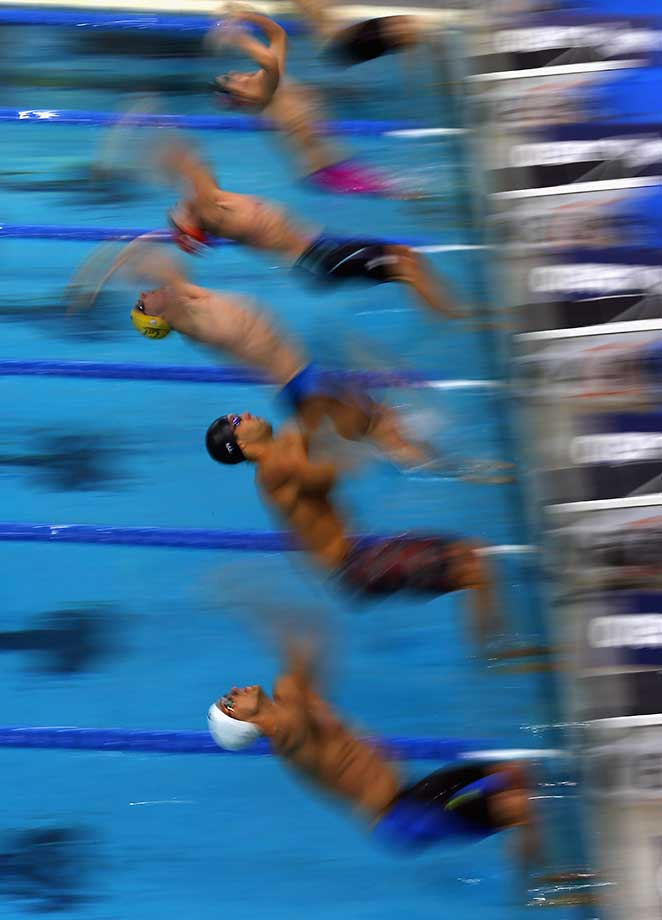 Swimmers at the start of the 200-meter backstroke during the Arena Pro Swim Series in Austin, Texas.