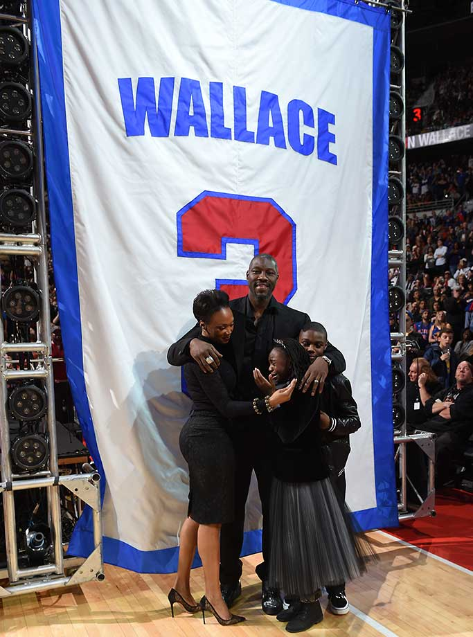 Former Detroit Pistons player Ben Wallace with his family after his number was retired during halftime of the game between the Detroit Pistons and the Golden State Warriors.