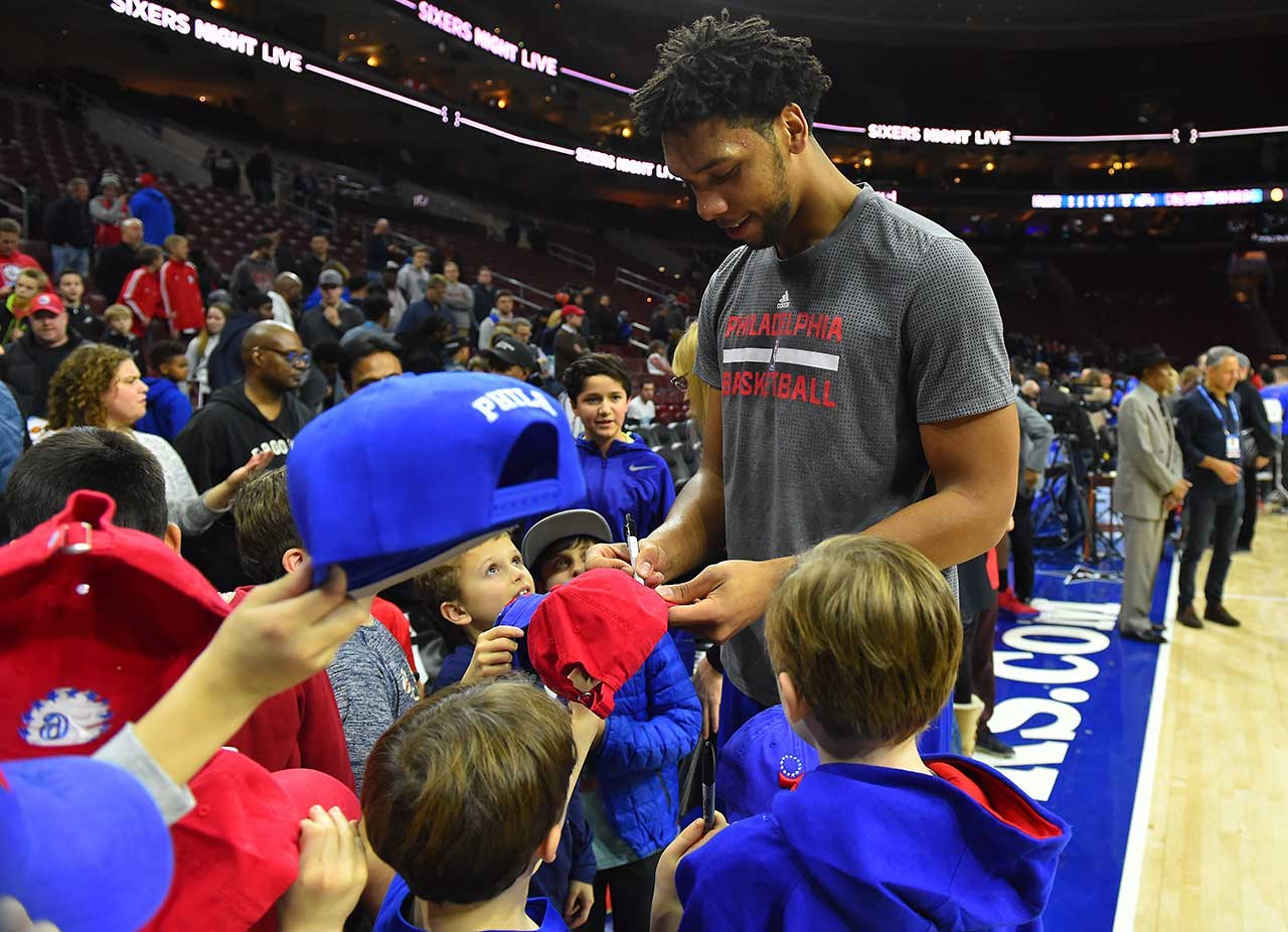 Jahlil Okafor of the Philadelphia 76ers signs autographs for young fans prior to a game against the Portland Trail Blazers.
