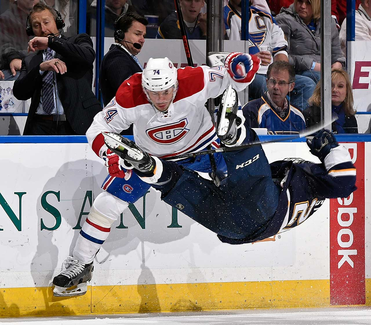 Alexei Emelin of the Montreal Canadiens checks Paul Stastny of the St. Louis Blues at the Scottrade Center in St. Louis.