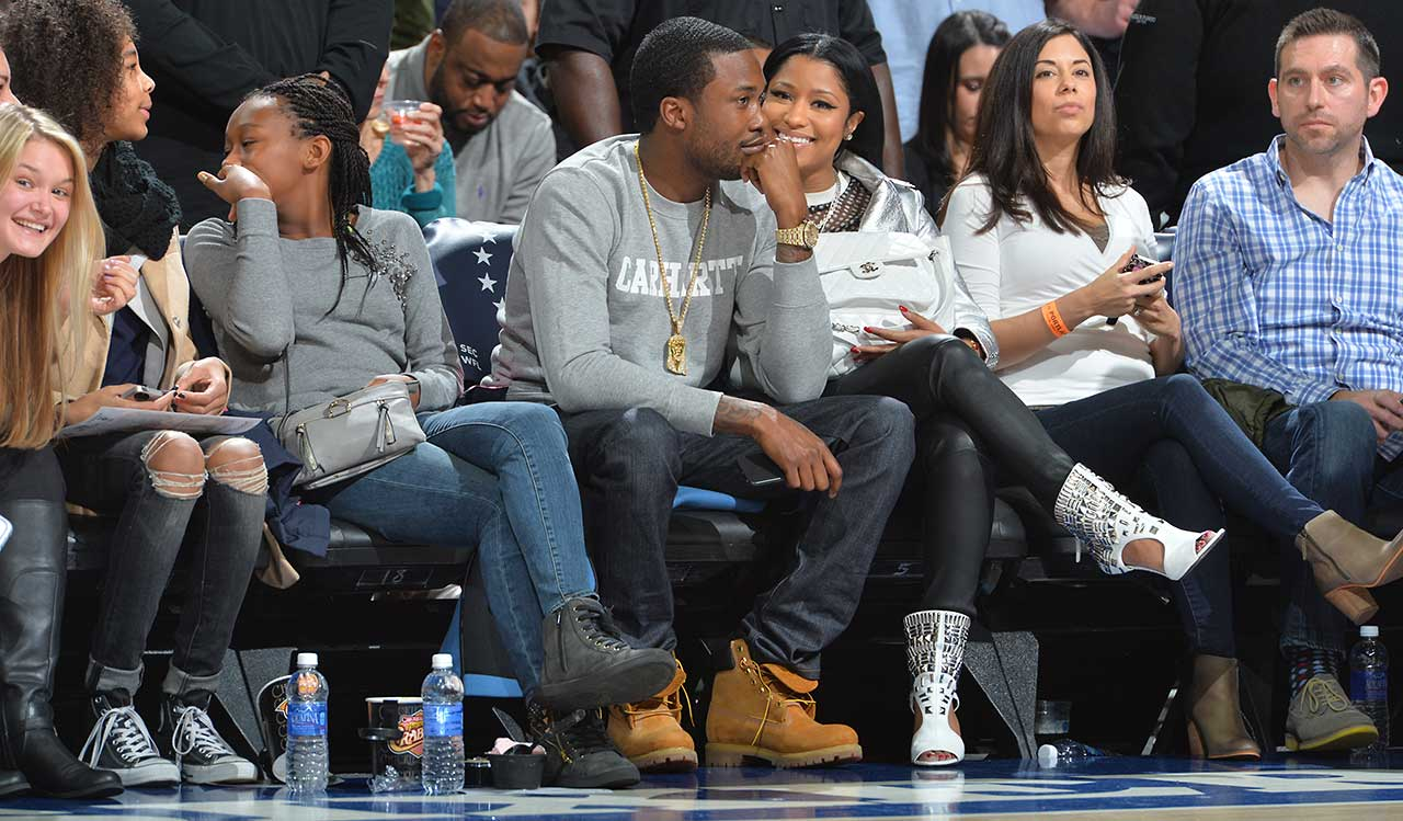 Recording artists Meek Mill and Nicki Minaj look on during the Philadelphia 76ers-Portland Trail Blazers game at Wells Fargo Center in Philadelphia.