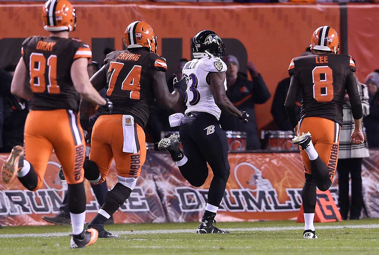 Will Hill of the Baltimore Ravens returns a blocked field goal attempt for a touchdown in front of Jim Dray (81), Cameron Erving (74) and Andy Lee (8) of the Cleveland Browns on the final play of their Monday night game in Week 12 of the 2015 NFL season.